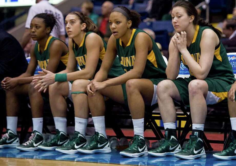 Siena players watch the final seconds of a MAAC women's semifinal college basketball game against Fairfield in Springfield, Mass., Saturday, March 3, 2012. Siena lost to Fairfield 63-48. (Jessica Hill / Special to the Times Union) Photo: Jessica Hill