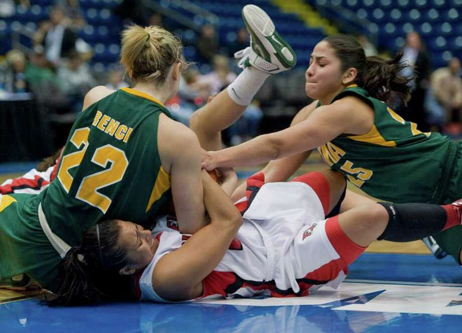 Siena's Lily Grenci, left, and Cristina Centeno, right, battle Fairfield's Desiree Pina, center for a ball in the second half of a MAAC women's semifinal college basketball game in Springfield, Mass., Saturday, March 3, 2012. Siena lost to Fairfield 63-48. (Jessica Hill / Special to the Times Union) Photo: Jessica Hill