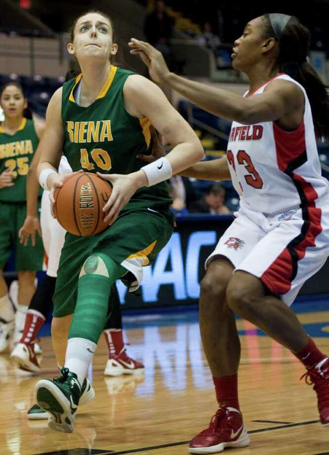 Siena's Clara Sole Anglada, left, is guarded by Fairfield's Taryn Johnson, right, in the first half of a MAAC women's semifinal college basketball game in Springfield, Mass., Saturday, March 3, 2012. (Jessica Hill / Special to the Times Union) Photo: Jessica Hill