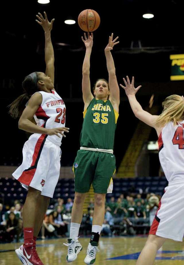 Siena's Maja Gerlyng (35) shoots a basket over Fairfield's Taryn Johnson, left, and Fairfield's Katie Cizynski, right, in the first half of a MAAC women's semifinal college basketball game in Springfield, Mass., Saturday, March 3, 2012. (Jessica Hill / Special to the Times Union) Photo: Jessica Hill