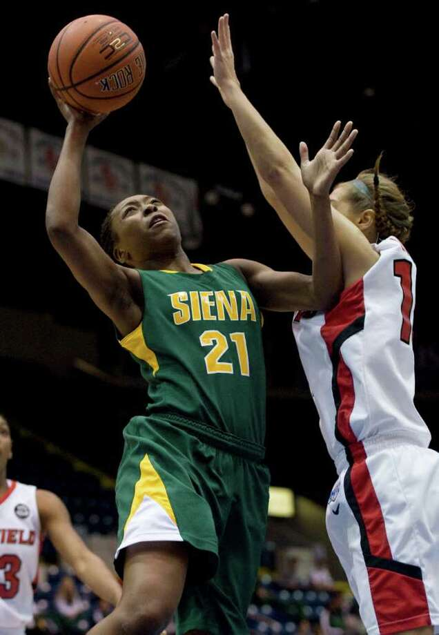 Siena's Tehresa Coles, shoots over Fairfield's Katelyn Linney, right, in the first half of a MAAC women's semifinal college basketball game in Springfield, Mass., Saturday, March 3, 2012. (Jessica Hill / Special to the Times Union) Photo: Jessica Hill