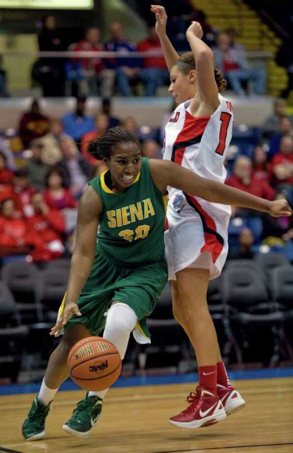 Siena's Kanika Cummings, left, drives around Fairfield's Katelyn Linney, right in the second half of a MAAC women's semifinal college basketball game in Springfield, Mass., Saturday, March 3, 2012. Siena lost to Fairfield 63-48. (Jessica Hill / Special to the Times Union) Photo: Jessica Hill