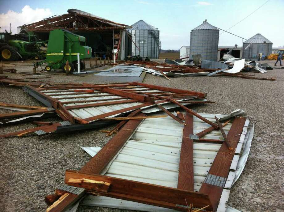 A barn damaged by what was to believed to be a tornado near Wadesville, Ind., is seen March 2, 2012. Powerful storms stretching from the U.S. Gulf Coast to the Great Lakes in the north wrecked two small towns, killed at least three people and bred anxiety across a wide swath of the country on Friday, in the second deadly tornado outbreak this week. (AP Photo/The Evansville Courier & Press, Denny Simmons) Photo: Denny Simmons, ASSOCIATED PRESS / Associated Press