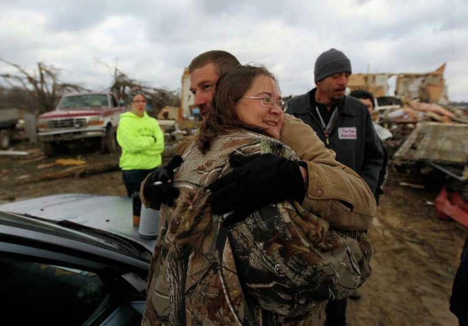 HOLTON, IN - MARCH 03:  Frank McRoberts hugs his aunt Vickie Patrick in front of her home that was destroyed when a tornado tore through the town on March 3, 2012 in Holton, Indiana.  Severe weather and tornados have swept across the U.S. causing heavy damage and leaving at least 28 dead. (Photo by Joe Raedle/Getty Images) Photo: Joe Raedle, Getty Images / 2012 Getty Images