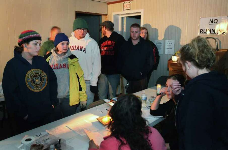 HENRYVILLE, IN - MARCH 02:  People check with volunteers in the basement of St. Francis Catholic Chu