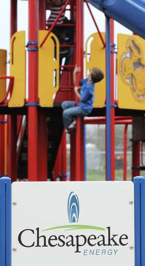 A child from McMullen County Elementary School in Tilden, Texas enjoys the new playground at the sch