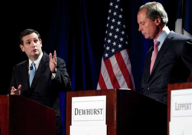 Texas solicitor general Ted Cruz, left, responds to Lt. Gov. David Dewhurst, during a debate, Thursday, Jan. 12, 2012 in Austin, Texas. Former Texas Solicitor General Ted Cruz repeatedly challenged Lt. Gov. David Dewhurst's conservative credentials Thursday night in the first formal debate of the five Republican candidates for the U.S. Senate. Photo: AP / SA