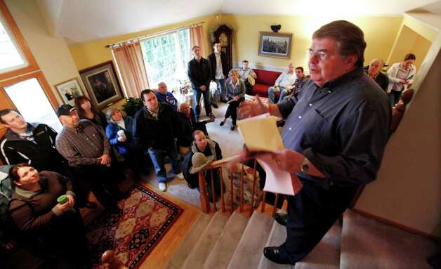 State Republican chairman Kirby Wilbur stands atop stairs in his home to explain to caucus attendees the process Saturday in Duval. Wilbur was host to five precincts at his home. Republicans crowded homes, churches and town halls across the state Saturday for Washington's GOP presidential caucuses, the first meaningful party contests in recent memory. While the caucuses are a nonbinding contest, state Republicans say it could create momentum for the four candidates on their last stop before Super Tuesday, when voting takes place in 10 states. Photo: AP