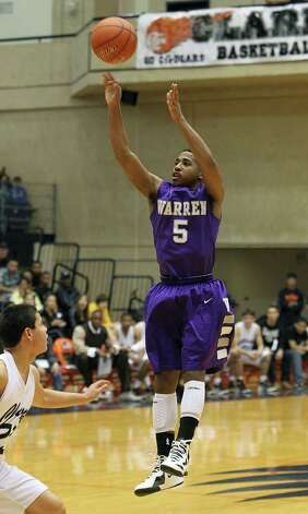 Warren's Marcus Keene (05) shoots a jumper against Clark's Justin Brickman (23) in the Region IV-5A boys basketball finals at UTSA on Saturday, Mar. 3, 2012. Warren defeated Clark, 65-56, to earn a trip to the state tournament. Photo: Kin Man Hui, Kin Man Hui/Express-News / © 2012 San Antonio Express-News