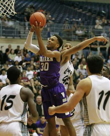 Warren's Jerell Ellis (30) grabs a rebound against Clark's Travis Matthews (15) and Shawn Gulley (45) in the Region IV-5A boys basketball finals at UTSA on Saturday, Mar. 3, 2012. Warren defeated Clark, 65-56, to earn a trip to the state tournament. Photo: Kin Man Hui, Kin Man Hui/Express-News / © 2012 San Antonio Express-News