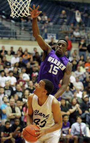 Warren's Taurean Waller-Prince (15) attempts a block on Clark's Shawn Gulley (45) in the Region IV-5A boys basketball finals at UTSA on Saturday, Mar. 3, 2012. Warren defeated Clark, 65-56, to earn a trip to the state tournament. Photo: Kin Man Hui, Kin Man Hui/Express-News / © 2012 San Antonio Express-News