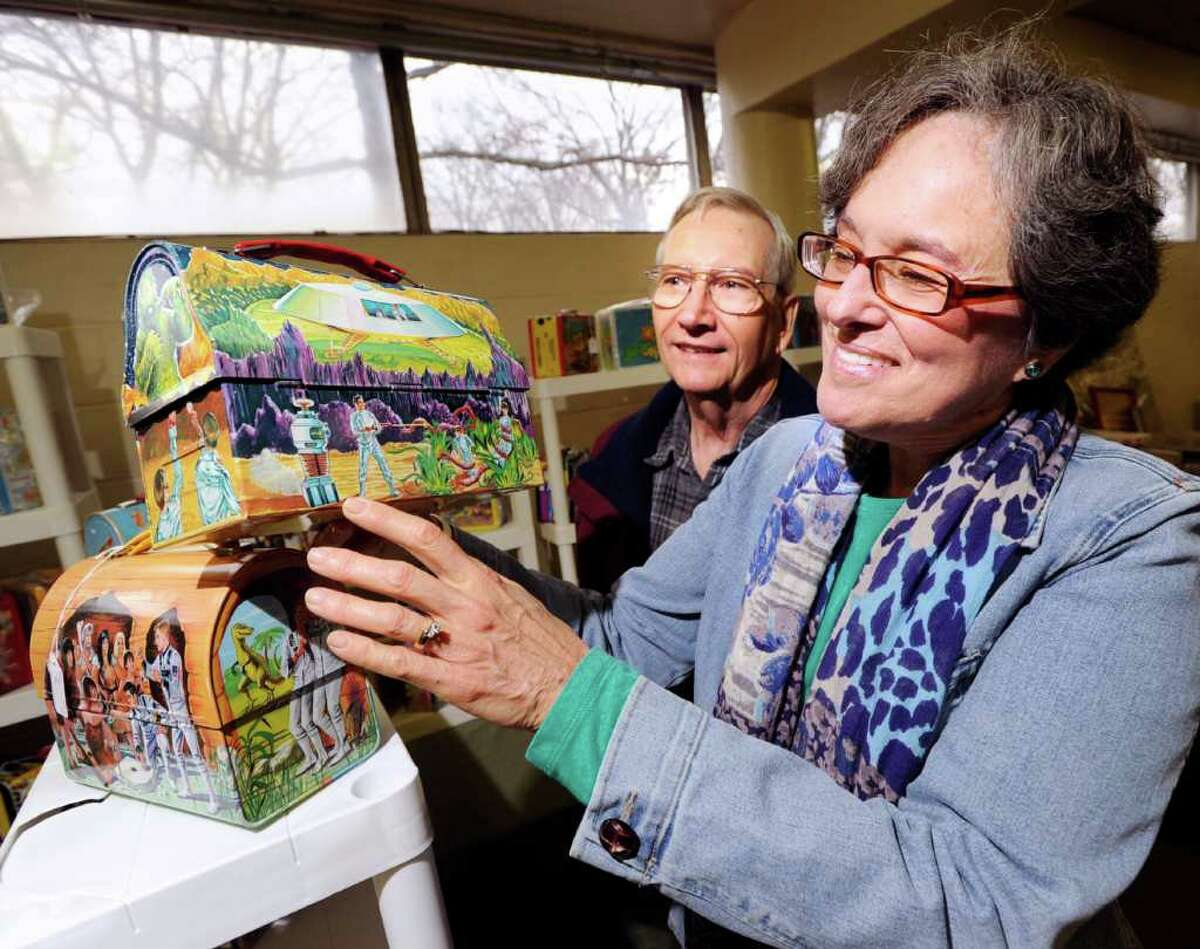 At right, Susan Taplin of Glenville points to the robot on a 1960s Lost In Space lunch box during the American antique toy and coin-op show at the Eastern Greenwich Civic Center, Saturday, March 3, 2012. Taplin said her cousin, Richard Tufeld, was the voice talent for the robot that was known for the famous catchphrase