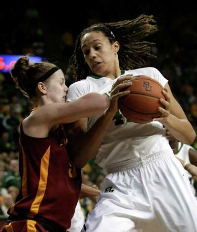 Baylor 's Brittney Griner (42) drives against Iowa State guard Lauren Mansfield, left, in the second half of an NCAA college basketball game Saturday, March 3, 2012, in Waco, Texas. Griner had a game-high 41-points in the 77-53 Baylor win. Photo: AP