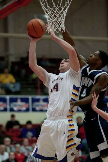 Sam Rowley of UAlbany drives the lane against Ferg Myrick of UNH, during the America East Conference