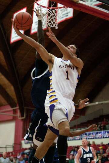 Tanner Gibson scores a layup and is fouled for UAlbany, during the America East Conference Tournamen