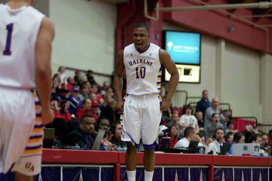 Mike Black (10) of UAlbany jumps in excitement as the Great Danes put together a big run against UNH, during the America East Conference Tournament Quarterfinal against the Wildcats at Chase Family Arena in Hartford, CT on March 3, 2012 (Shane Bufano/Special to the Times Union). Photo: Shane Bufano