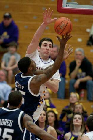 Sam Rowley of UAlbany (center) blocks a shot by Ferg Myrick of UNH, during the America East Conference Tournament Quarterfinal against the Wildcats at Chase Family Arena in Hartford, CT on March 3, 2012 (Shane Bufano/Special to the Times Union). Photo: Shane Bufano