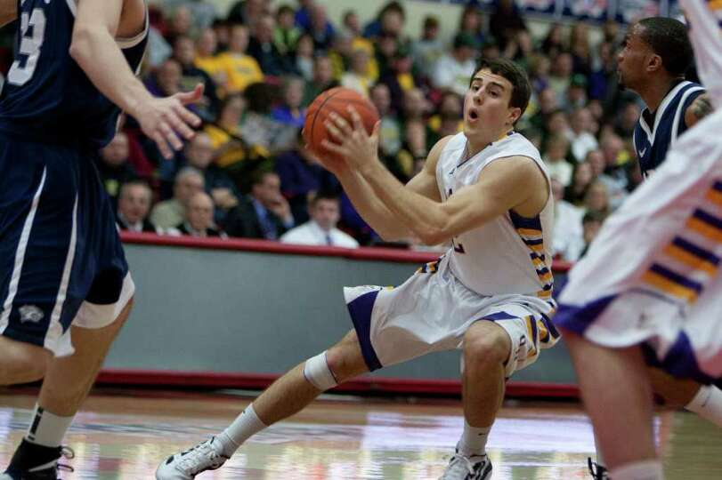 Logan Aronhalt of UAlbany drives the lane, during the America East Conference Tournament Quarterfina