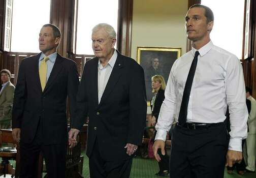 Former Texas NCAA college football coach, Darrell Royal, center, is flanked by seven-time Tour de France winner Lance Armstrong, left, and actor Matthew McConaughey, right, as they enter the Senate Chamber of the State Capitol in Austin, Texas, on Tuesday, Feb. 28, 2012. Royal's wife, Edith Royal, announced during a joint legislative hearing that the family foundation named after her husband, DKR Fund for Alzheimer's Research, that would fund Alzheimer's disease research in Texas. Armstrong and McConaughey attended the hearing to support the foundation Royal. (AP Photo/Austin American-Statesman, Rodolfo Gonzalez) MAGS OUT; NO SALES; INTERNET AND TV MUST CREDIT PHOTOGRAPHER AND STATESMAN.COM Photo: AP