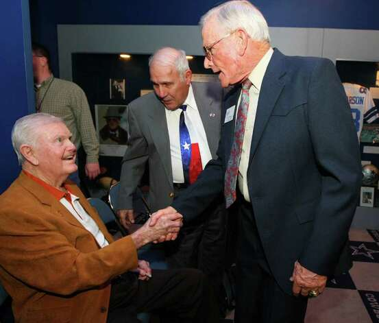 Former Texas football coach Darrell Royal, left, shakes hands with G.A. Moore Jr, right,  the winningest high school football coach in Texas history, at a reception before the induction for the 2012 class of the Texas Sports Hall of Fame, Wednesday, Feb. 29, 2012 in Waco, Texas. (AP Photo/Waco Tribune Herald, Photo: AP