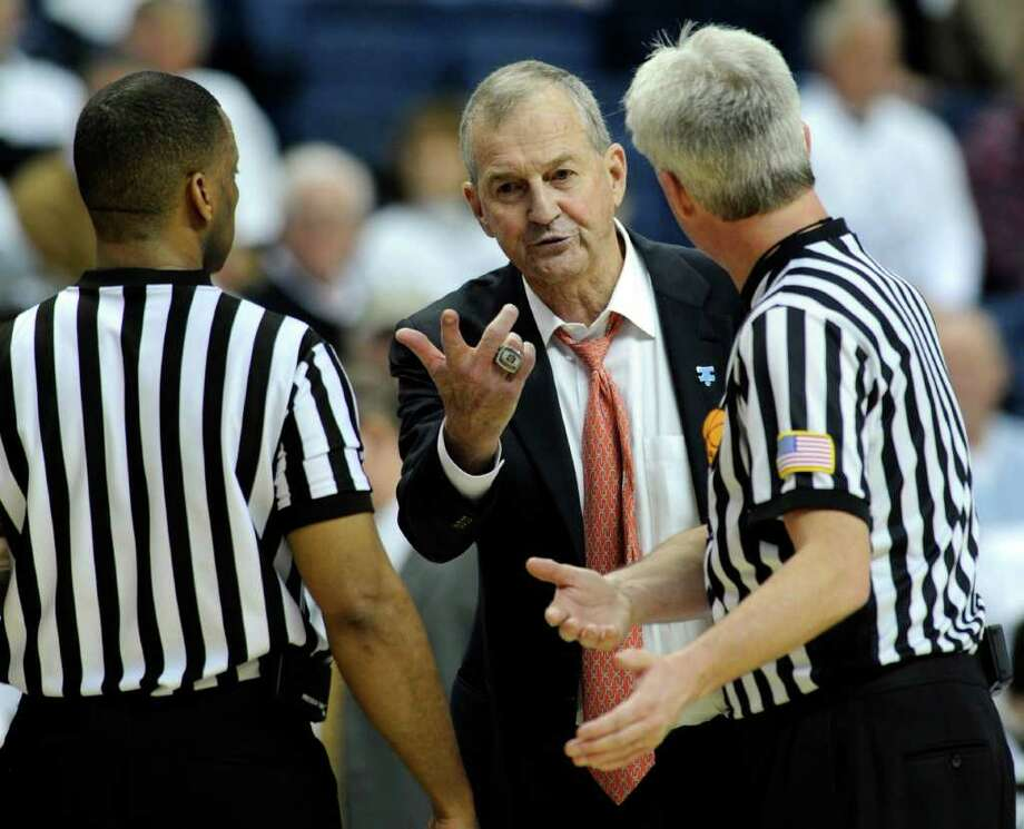 Connecticut coach Jim Calhoun speaks with officials in the second half of Connecticut's 74-65 victory over Pittsburgh in an NCAA college basketball game in Storrs, Conn., on Saturday, March 3, 2012. (AP Photo/Fred Beckham) Photo: Fred Beckham, Associated Press / FR153656 AP