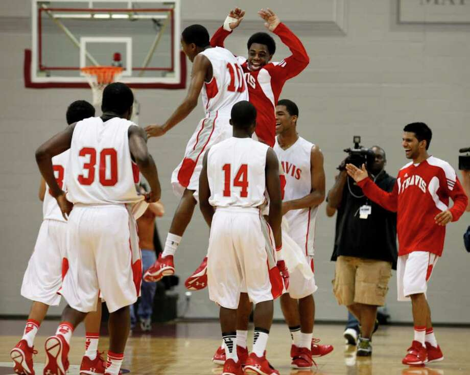 The Fort Bend Travis Tigers celebrate after beating Fort Bend Hightower for the 5A regional finals, March 3, 2012 in Houston. Photo: Eric Kayne, For The Chronicle / © 2012 Eric Kayne
