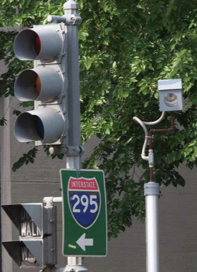 A camera is placed near a traffic light for drivers who run red lights on Constitution Avenue in Washington, DC. in 2001. The camera takes a picture of the car and license plate and the offender is mailed a citation. (Photo by Mark Wilson/Getty Images) Photo: Mark Wilson, Getty Images / Getty Images North America