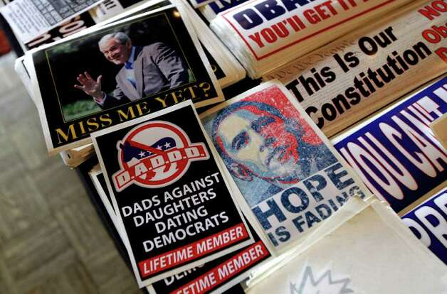 Bumper stickers are shown for sale during a Washington state Republican caucus meeting Saturday in Puyallup. Photo: AP