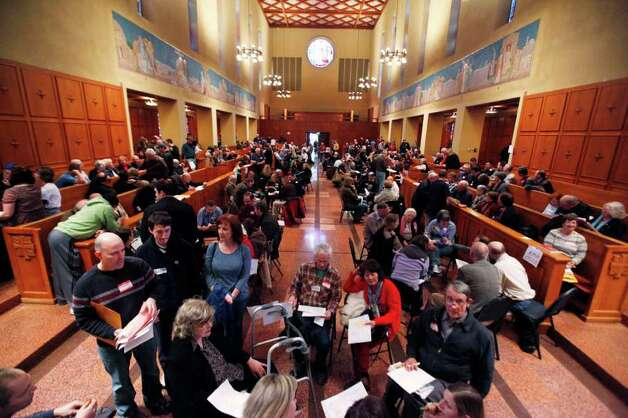 Republican caucus attendees fill the chapel of the former St. Edward Seminary Saturday, in Kenmore. Nearly 600 Republicans from 74 precincts crowded in the venue, now part of the Bastyr University campus. Republicans crowded homes, churches and town halls across the state Saturday for Washington's GOP presidential caucuses, the first meaningful party contests in recent memory. While the caucuses are a nonbinding contest, state Republicans say it could create momentum for the four candidates on their last stop before Super Tuesday, when voting takes place in 10 states. Photo: AP