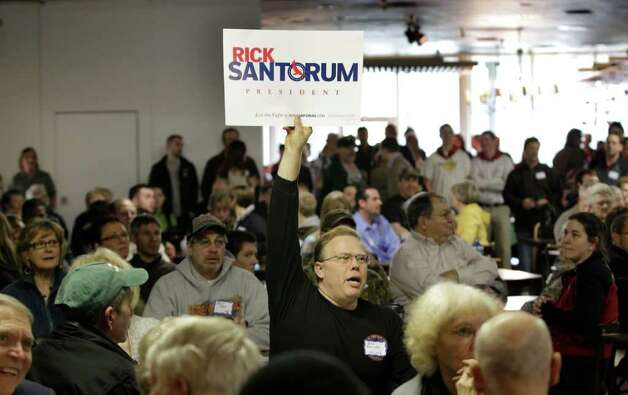 Ron Phillps shows his support for Republican presidential candidate, former Pennsylvania Sen. Rick Santorum, during a Washington state caucus meeting Saturday in Puyallup. Photo: AP