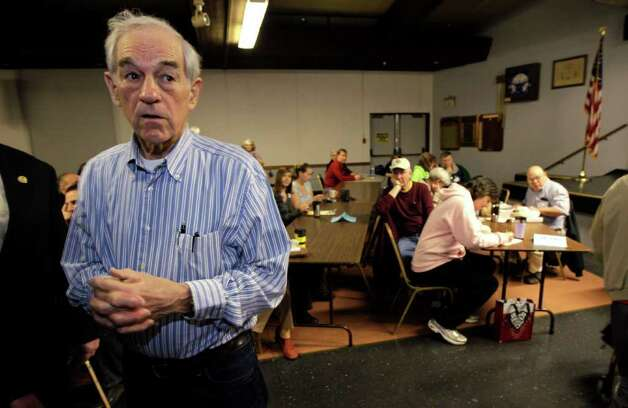 Republican presidential candidate Rep. Ron Paul, R-Texas, pauses as he greets voters taking part in Washington state caucus meetings Saturday in Puyallup.. Photo: AP