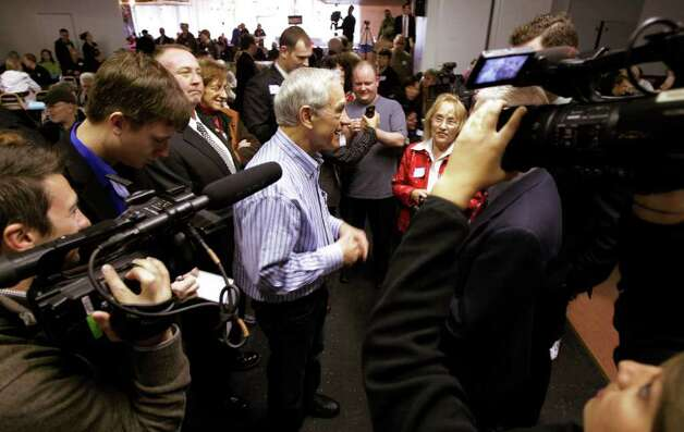 Republican presidential candidate Rep. Ron Paul, R-Texas, talks to reporters as he attends a Washington state caucus meeting Saturday in Puyallup. Photo: AP