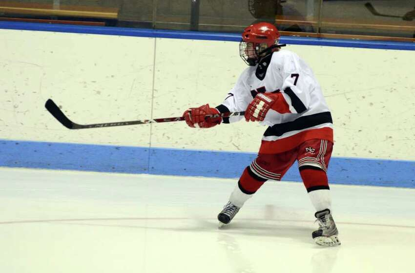 New Canaan's Abbey Buckenheimer (7) passes the puck during the Connecticut High School Girls' Hockey Association Championship Game against West Hartford at Ingalls Rink in New Haven on Saturday, Mar. 3, 2012.