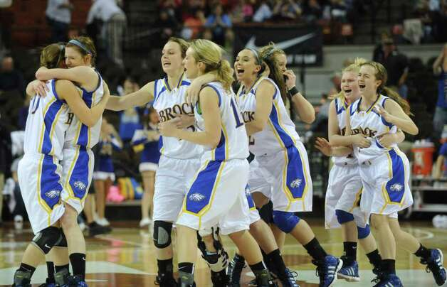 Members of the Brock girls basketball team celebrate after defeating Poth, 52-49, in 2A state finals action in Austin on Saturday, March 3, 2012. Billy Calzada / San Antonio Express-News  Brock Lady Eagles vs. Poth Pirettes Photo: Billy Calzada, Express-News / San Antonio Express-News