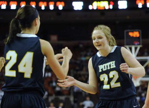 Claire Raabe (22) of Poth and Micah Weaver (24) encourage one another during UIL Conference 2A state finals action against Brock in Austin on Saturday, March 3 , 2012. Billy Calzada / San Antonio Express-News  Brock Lady Eagles vs. Poth Pirettes Photo: Billy Calzada, Express-News / San Antonio Express-News