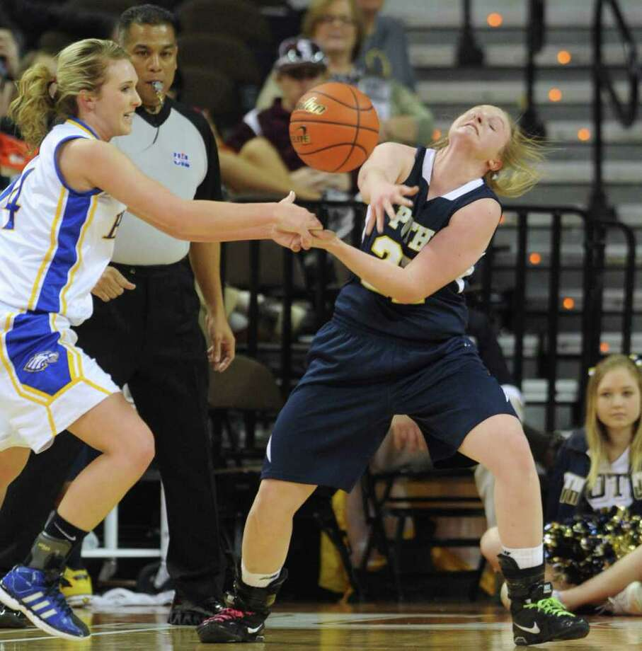Taylor Wallace, left, of Brock and Claire Raabe of Poth battle for a loose ball during UIL Conference 2A state finals action in Austin on Saturday, March 3 , 2012. Billy Calzada / San Antonio Express-News  Brock Lady Eagles vs. Poth Pirettes Photo: Billy Calzada, Express-News / San Antonio Express-News