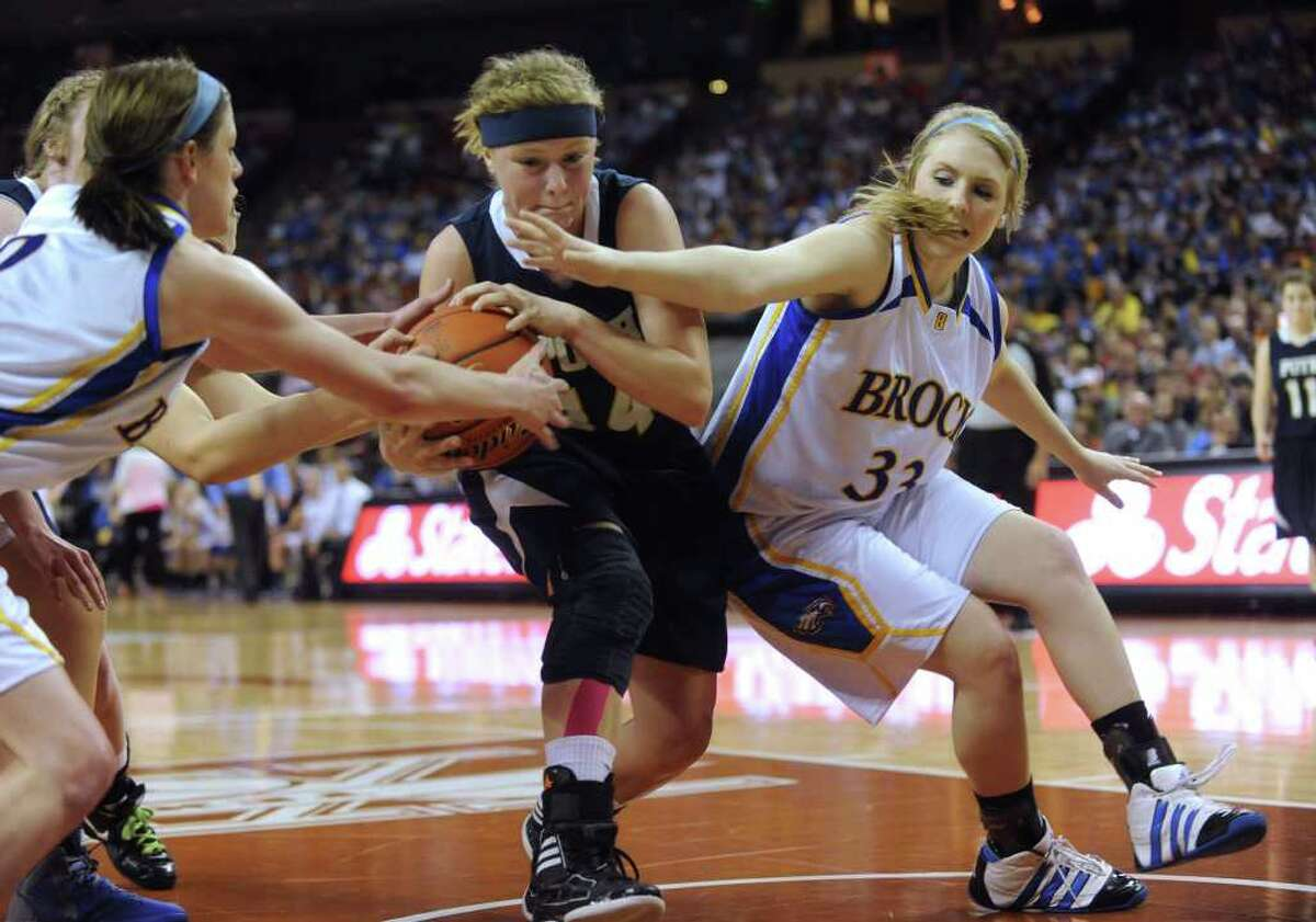 Kelli Kolodziej of Poth, middle, is tied up by Kamy Cole, left, and Taylor Fulmer of Brock during UIL Conference 2A state finals action in Austin on Saturday, March 3, 2012. Brock won the game, 52-49. Billy Calzada / San Antonio Express-News Brock Lady Eagles vs. Poth Pirettes