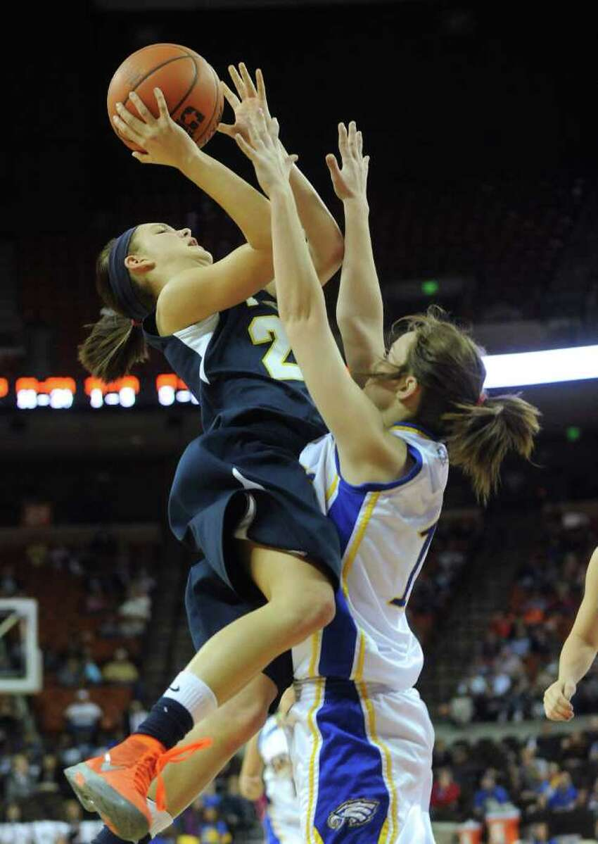 Micah Weaver of Poth shoots over Savannah Fisher of Brock during UIL Conference 2A state finals action in Austin on Saturday, March 3, 2012. Billy Calzada / San Antonio Express-News Brock Lady Eagles vs. Poth Pirettes