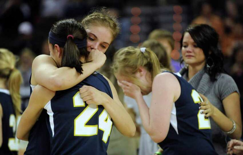 Micah Weaver (24) and Jordan Kotara of Poth comfort one another after losing, 52-49, to Brock in the UIL Conference 2A state championship game in Austin on Saturday, March 3, 2012. Billy Calzada / San Antonio Express-News Brock Lady Eagles vs. Poth Pirettes