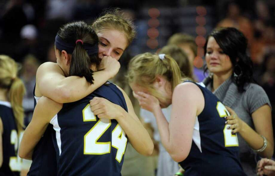 Micah Weaver (24) and Jordan Kotara of Poth comfort one another after losing, 52-49, to Brock in the UIL Conference 2A state championship game in Austin on Saturday, March 3, 2012. Billy Calzada / San Antonio Express-News  Brock Lady Eagles vs. Poth Pirettes Photo: Billy Calzada, Express-News / San Antonio Express-News
