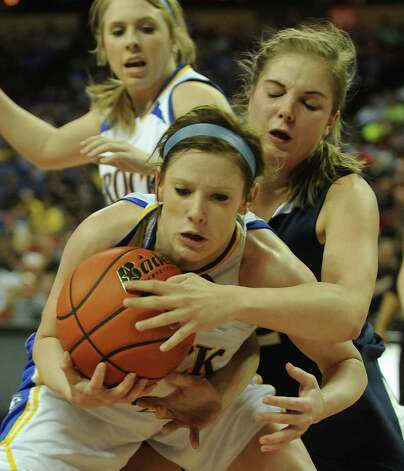 Kamey Cole of Brock, front and Jordan Kotara of Poth battle for the ball during UIL Conference 2A state finals action in Austin on Saturday, March 3 , 2012. Billy Calzada / San Antonio Express-News  Brock Lady Eagles vs. Poth Pirettes Photo: Billy Calzada, Express-News / San Antonio Express-News