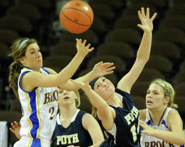 Kamey Cole (2) and Taylor Wallace (14) of Brock battle Annika Eckel (30) and Kelli Kolodziej (14) of Poth during UIL Conference 2A state finals action in Austin on Saturday, March 3, 2012. Billy Calzada / San Antonio Express-News  Brock Lady Eagles vs. Poth Pirettes Photo: Billy Calzada, Express-News / San Antonio Express-News