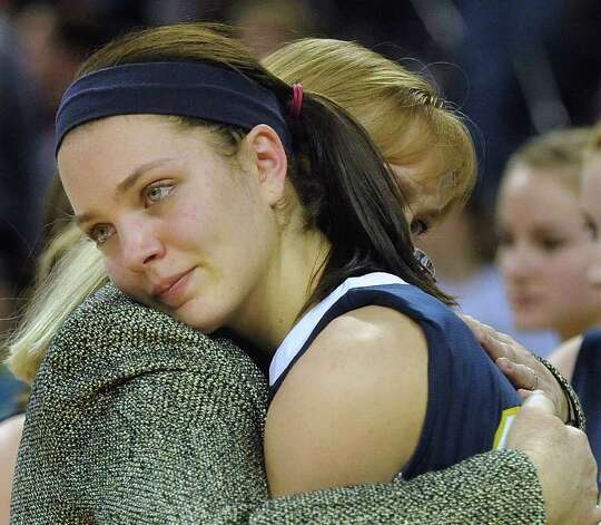 Micah Weaver is embraced by Poth coach Peggy Hosek, after they lost, 52-49, to Brock in 2A state finals action in Austin on Saturday, March 3, 2012. Billy Calzada / San Antonio Express-News  Brock Lady Eagles vs. Poth Pirettes Photo: Billy Calzada, Express-News / San Antonio Express-News