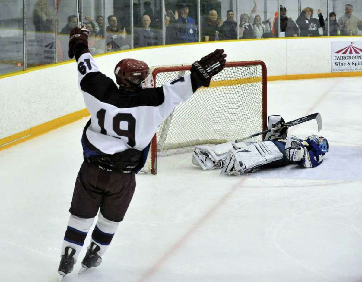 Brookfield/Bethel/Danbury's Nick Melvin celebrates after assisting Trevor Kurijaka for a goal on Newtown goalie Mike Allwein during the SWC boys hockey championship game at Danbury Arena on Saturday, March 3, 2012. Brookfield/Bethel/Danbury won 5-1.