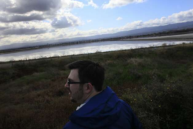 Josh Sonnenfeld, Save the Bay campaign manager, looks over the  salt ponds in Redwood City where Cargill is proposing a development project on Monday, February 27, 2012 in Redwood City, Calif. Photo: Lea Suzuki, The Chronicle