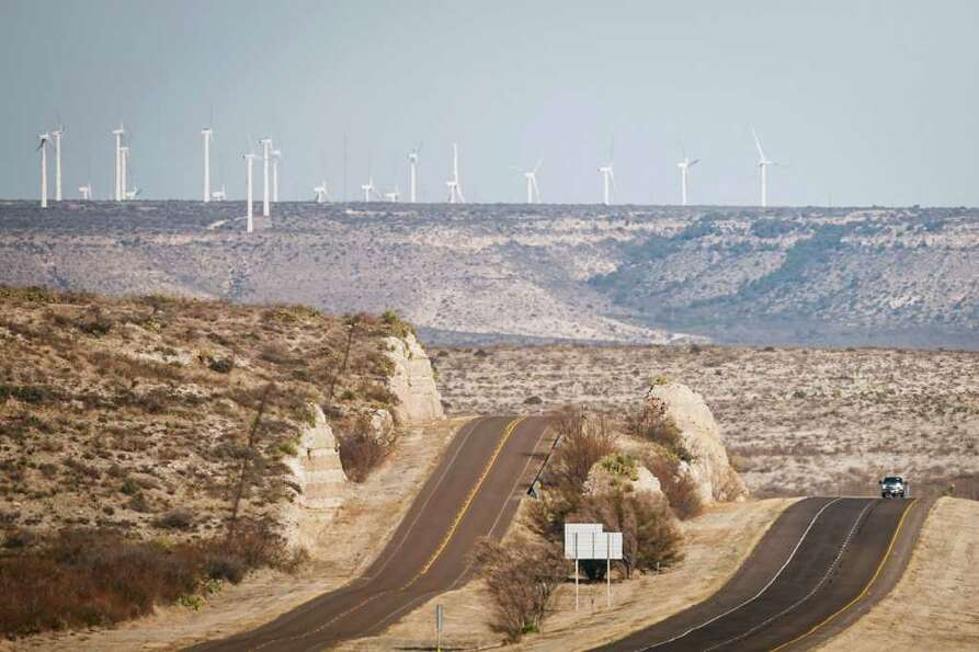 Travelers on I-10 whizz by the BP Sherbino Mesa II Wind Farm, Sunday, Feb. 19, 2012, in Fort Stockto