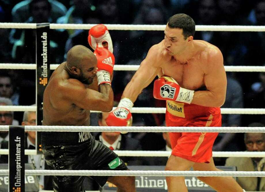 Heavyweight world boxing champion Wladimir Klitschko of Ukraine, right, knocks out Jean-Marc Mormeck of France in the 4th Round of their WBA, IBF, WBO and IBO title bout in Duesseldorf, Germany, Saturday, March 3, 2012. Photo: AP