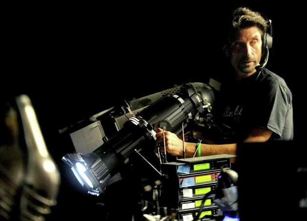 Brad Shwidock runs the lights at Curtain Call in Stamford on Thursday, April 28, 2011. Photo: Lindsay Niegelberg
