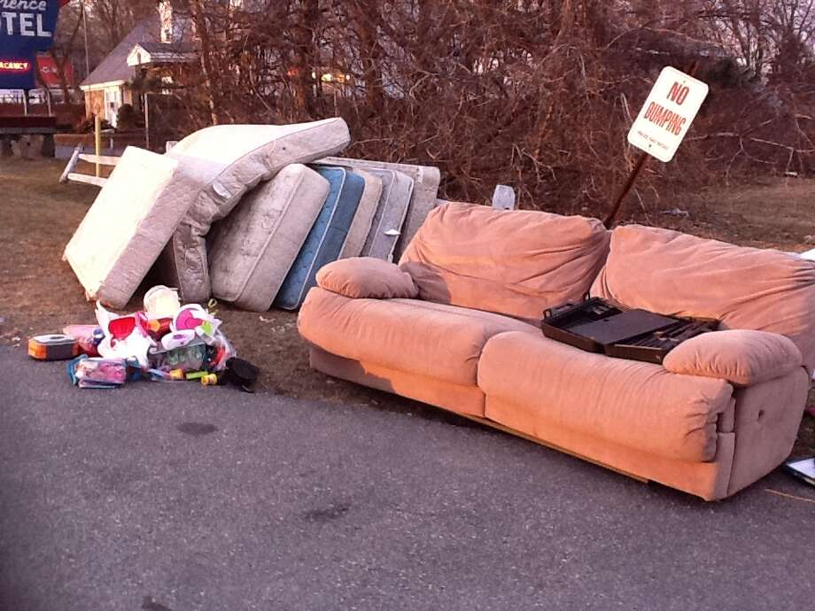 "Items left at the Salvation Army store along Central Avenue in Colonie last Monday, despite a ""No Dumping"" sign. (Photo submitted by Celeste Sodano)"