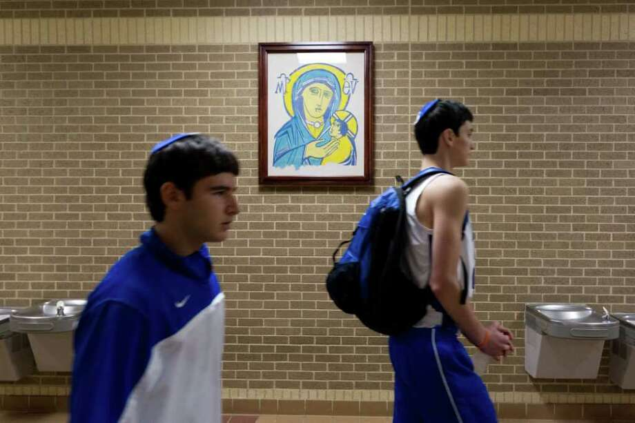 Beren Academy players arrive at the arena to face Abilene Christian in the TAPPS 2A state championship basketball game at Nolan Catholic High School on Saturday, March 3, 2012, in Fort Worth. Photo: Smiley N. Pool, Houston Chronicle / © 2012  Houston Chronicle